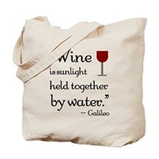 Wine is sunlight held together by water Tote Bag