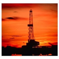 Oil drilling rig, Russia, at sunset Poster