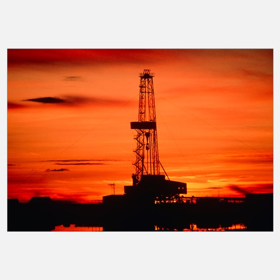 Oil drilling rig, Russia, at sunset