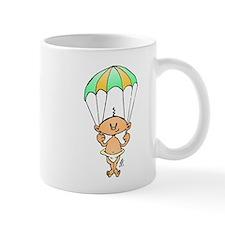 Baby hanging from a parachute Mug