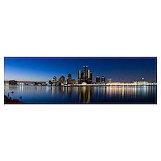 Buildings in a city lit up at dusk, Detroit River, Poster
