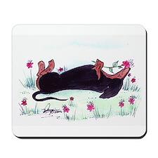 Dachshund enjoying flowers Mousepad