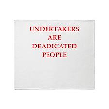 undertaker joke Throw Blanket