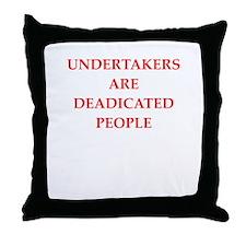 undertaker joke Throw Pillow