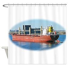 Salt water ship Emile gets a tug assist Shower Cur