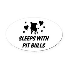 Sleeps with Pit Bulls Oval Car Magnet
