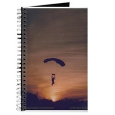 This journal displays a skydiver at sunset