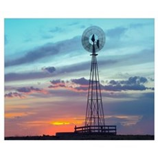 Windmill producing electricity at sunset example o Poster