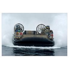 A landing craft air cushion approaches the well de Poster