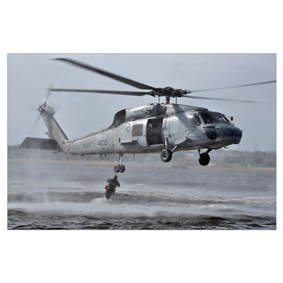 A search and rescue swimmer jumps from an SH-60F S Poster