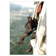 A search and rescue swimmer student jumps from a M Canvas Art