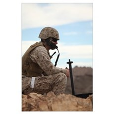 A U.S. Marine uses a field phone to communicate wi Poster