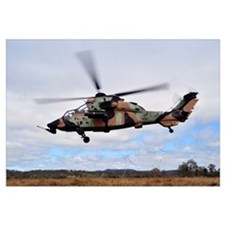 An Australian Army Tiger helicopter flies a reconn