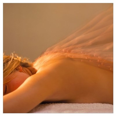 Time-exposure image of a woman having a massage Poster