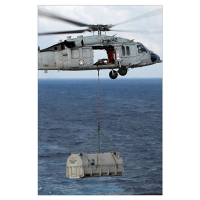 MH-60S Sea Hawk en route with a shipment of suppli Poster