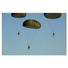 Paratroopers descend through the sky Poster