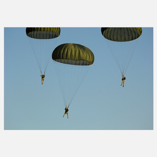 Paratroopers descend through the sky