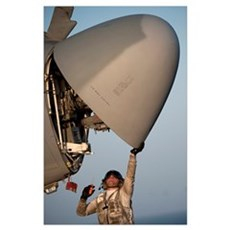 Petty Officer inspects the radar of an EA-6B Prowl Poster