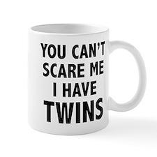 You can't scare me. I have twins. Mug