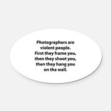 Photographers are violent people. Oval Car Magnet