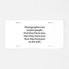 Photographers are violent people. Aluminum License