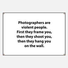Photographers are violent people. Banner
