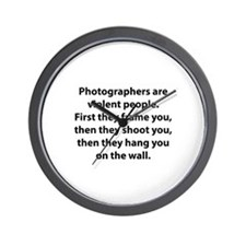 Photographers are violent people. Wall Clock