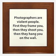 Photographers are violent people. Framed Tile