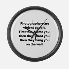 Photographers are violent people. Large Wall Clock