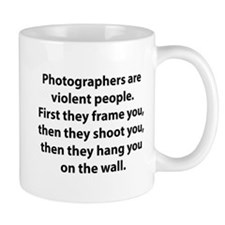 Photographers are violent people. Small Mug