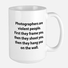 Photographers are violent people. Coffee Mug