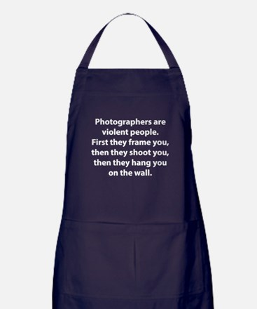 Photographers are violent people. Apron (dark)
