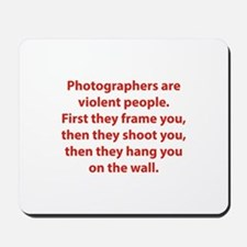 Photographers are violent people. Mousepad