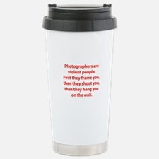 Photographers are violent people. Travel Mug