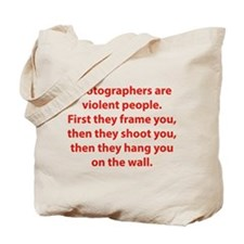 Photographers are violent people. Tote Bag