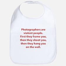 Photographers are violent people. Bib
