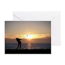 Playing Golf At Sunset Greeting Card