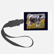 Alaskan malamute in a field of flowers Luggage Tag