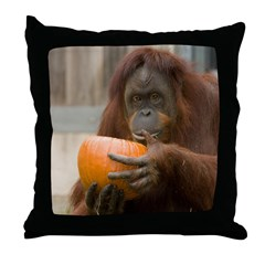 Orangutan Eating Pumpkin Throw Pillow