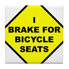 sniffing bicycle seats Tile Coaster