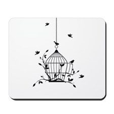 Free birds with open birdcage Mousepad