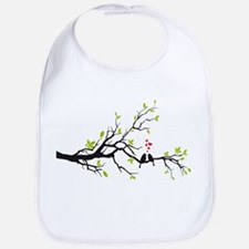 Birds in love with red hearts on spring tree Bib