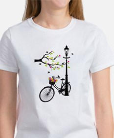 Old bicycle with lamp, flower basket, birds, tree