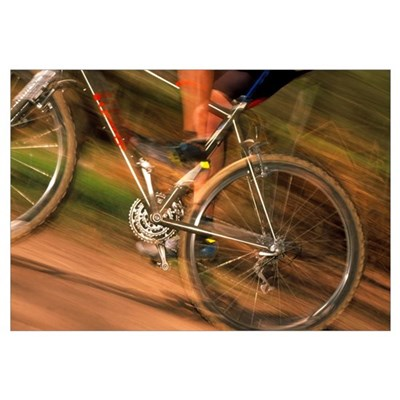 Time-exposure image of a cyclist riding a bicycle Poster