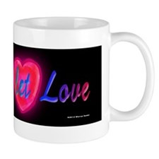 Love and let love cursive on black Mug