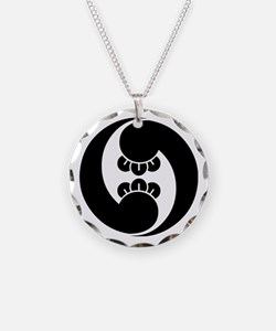 Right, two clove swirls Necklace