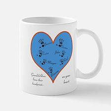 Handprints on your heart - 7 kids Mug