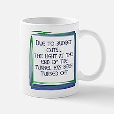budgetcutsfix Mugs
