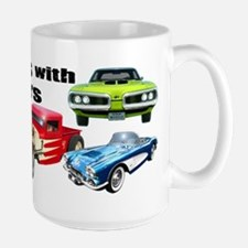 StillPlaysCars-mug Mugs