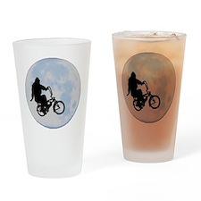 Bigfoot on bicycle Drinking Glass